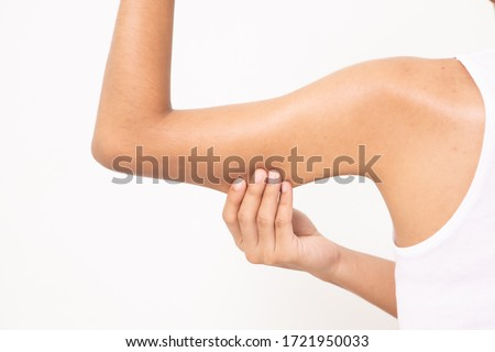 woman grabbing skin on her upper arm with the drawing arrows, Lose weight and liposuction cellulite removal concept, Isolated on white background. Royalty-Free Stock Photo #1721950033