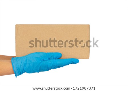 Delivery man holding cardboard boxes in medical rubber gloves. copy space. Fast and free Delivery transport . Online shopping and Express delivery  #1721987371