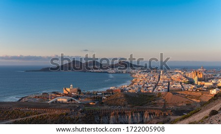 Cityscape. Panoramic view of the city of Las Palmas de Gran Canaria at sunset with Las Canteras beach and La Isleta mountains in the background #1722005908
