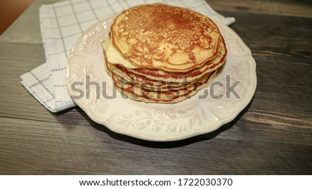 Picture of fluffy plain pancakes without butter of syrup.