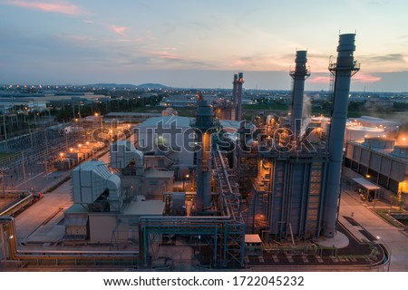 Gas turbine electrical power plant during sunset and twilight time Royalty-Free Stock Photo #1722045232