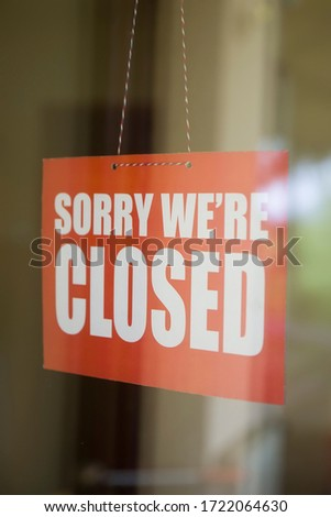 Closed sign board hanging on the glass door of cafe or small store #1722064630