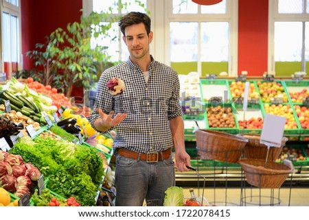 Man shopping in an organic grocery store #1722078415