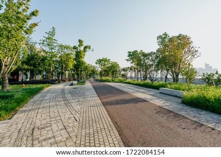 empty road in city park Royalty-Free Stock Photo #1722084154