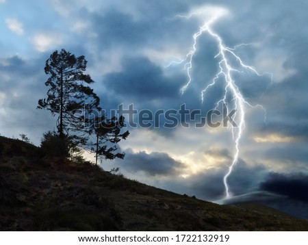 A picture of large lightning crossing the stormy sky
