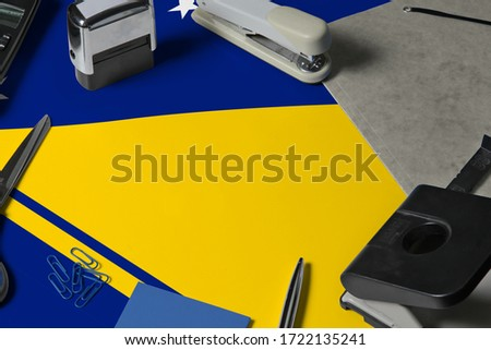 Tokelau flag with office clerk workplace background. National stationary concept with office tools. #1722135241