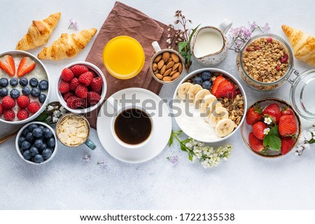 Healthy breakfast set on grey background. The concept of delicious and healthy food. Top view, copy space. Royalty-Free Stock Photo #1722135538