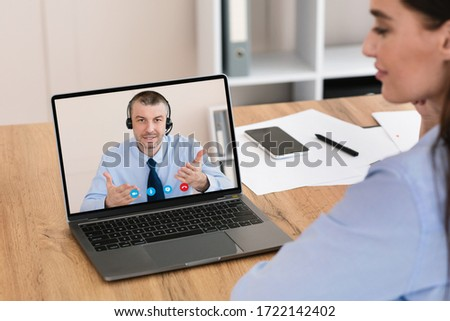 Businesswoman Having Online Conference Meeting With Coworker Sitting At Laptop Working Distantly In Modern Office. Business Video Call. Selective Focus #1722142402