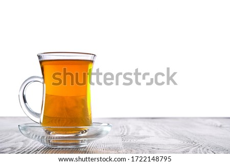 Low angle photo of cup with hot tea with copy space on white background #1722148795