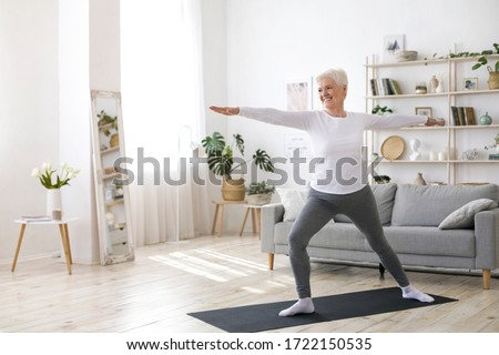 Sport On Retirement. Active Senior Woman Doing Pilates Workout At Home, Training In Living Room During Quarantine #1722150535