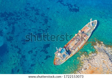 Shipwreck in Cyprus. Pathos. White stones. The ship ran aground view from above. The ship crashed on the coastal rocks. Abandoned sea vessels. View of the shipwreck from a drone. Sights Of Cyprus. #1722153073
