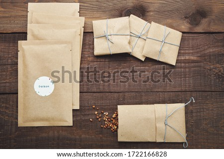 Paper bags with seeds for planting. Wooden table. View from above. Royalty-Free Stock Photo #1722166828
