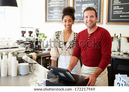 Male And Female Staff In Coffee Shop  Royalty-Free Stock Photo #172217969