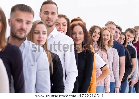 group of diverse young people standing in line #1722216511