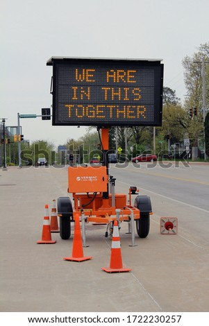 """Iowa City, Iowa - March 4th 2020: Construction sign outside of a hospital stating """"We are in this together"""" #1722230257"""