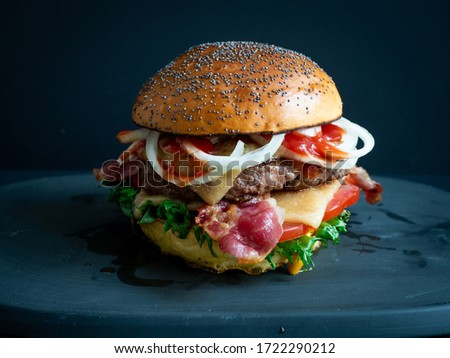Picture of a fresh made bacon cheese burger