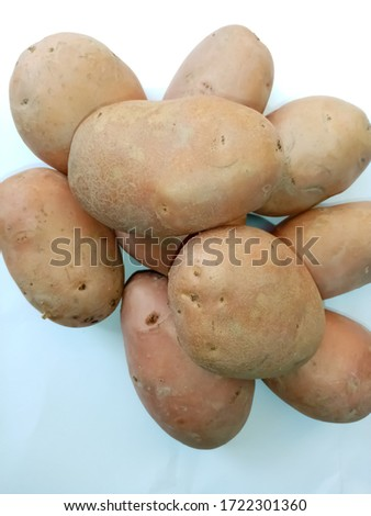 Red potatoes closeup picture on white background