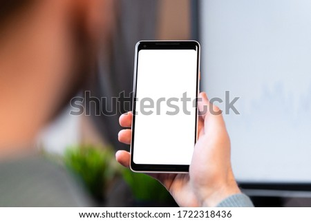 Businessman Holding Mobile Phone With Blank Screen and Calling His Colleagues By Video Chat. Copy Space. Empty Space #1722318436