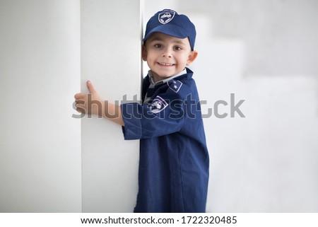 Little boy in police uniform