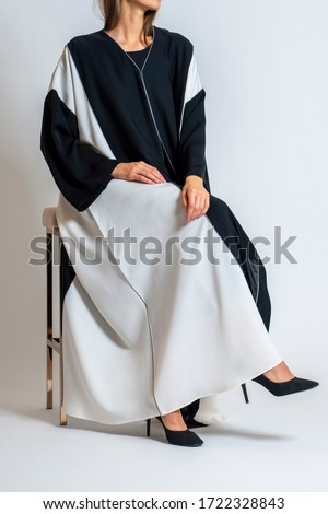 arabic muslim woman in stylish abaya, in white background - Image Royalty-Free Stock Photo #1722328843