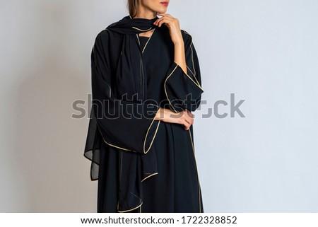 arabic muslim woman in stylish abaya, in white background - Image Royalty-Free Stock Photo #1722328852
