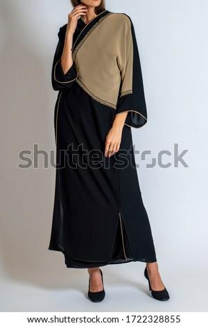 arabic muslim woman in stylish abaya, in white background - Image Royalty-Free Stock Photo #1722328855