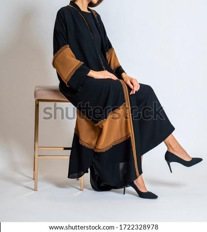 arabic muslim woman in stylish abaya, in white background - Image Royalty-Free Stock Photo #1722328978