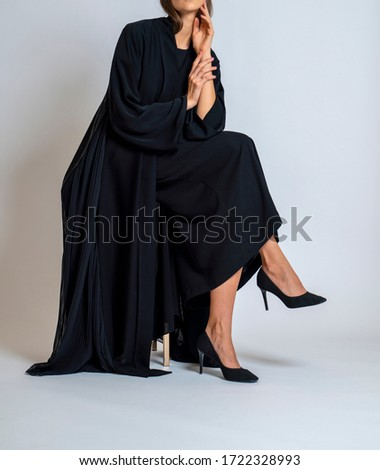 arabic muslim woman in stylish abaya, in white background - Image Royalty-Free Stock Photo #1722328993
