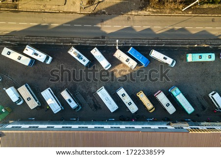 Aerial view of many cars and buses moving on a busy city street. #1722338599