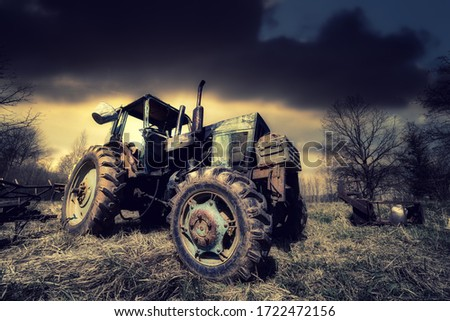 old tractor on the grass field Royalty-Free Stock Photo #1722472156