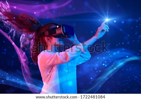 Woman with glasses of virtual reality. Future technology concept. Colorful neon lights. Royalty-Free Stock Photo #1722481084