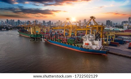 Aerial view and top view cargo ship port in the export and import business and logistics international goods. Shipping cargo to harbor by crane #1722502129