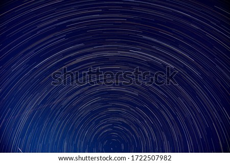 Star trails around the  Big Dipper, constellation in the northern hemisphere during Covid 19 pandemic. Little airplane activity with a astronomy flare captured on 26 April 2020