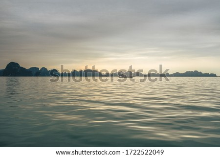 The beauty of UNESCO Heritage site Ha Long Bay, Quang Ninh, Vietnam.  Sunset in Ha Long Bay.