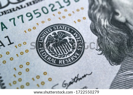 macro photo of federal reserve system symbol on hundred dollar bill. shallow focus. close-up with fine and sharp texture Royalty-Free Stock Photo #1722550279