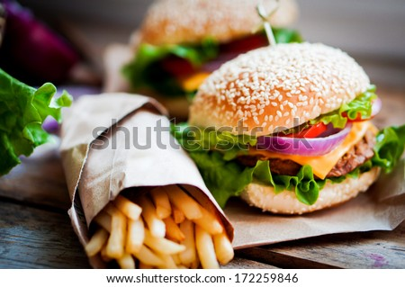 Closeup of home made burgers on wooden background #172259846