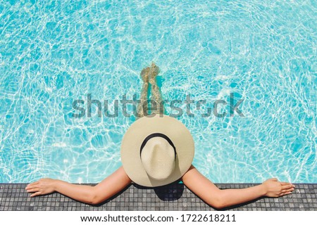 Carefree woman relaxation in swimming pool summer Holiday concept Royalty-Free Stock Photo #1722618211