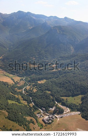 view from Fuente Dé Cable car transport system to elevate  tourist high up to the mountain peaks #1722619993
