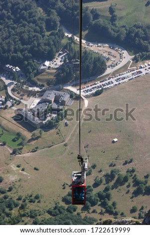 Fuente Dé Cable car transport system to elevate  tourist high up to the mountain peaks #1722619999