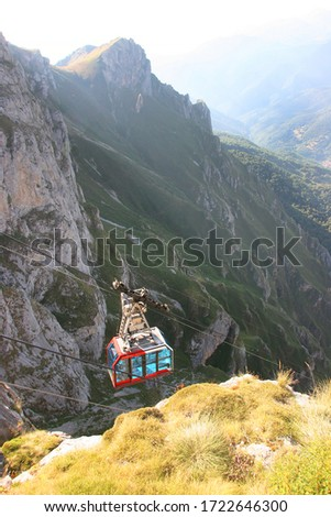 Fuente Dé Cable car transport system to elevate  tourist high up to the mountain peaks #1722646300
