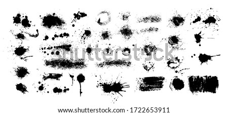 Set of blots. Black spots of paint on a white background. Grunge frame of paint. Vector