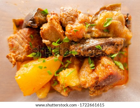 beef braised with potatoes top view isolate on white inside plastic food box #1722661615