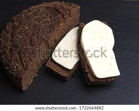 slices of Borodino bread on malt and unleavened sourdough with pieces of suluguni cheese #1722664882