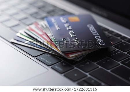 Online credit card payment for purchases from online stores and online shopping, Credit card close up shot.  Royalty-Free Stock Photo #1722681316