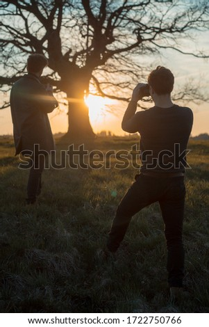 Two photographers take pictures of nature at sunset. #1722750766