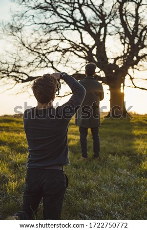 Two photographers take pictures of nature at sunset. #1722750772