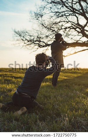 Two photographers take pictures of nature at sunset. #1722750775