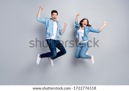 Full body photo of attractive lady handsome funny guy crazy fan jumping high up celebrating football team winning wear casual denim shirts outfit isolated grey color background Royalty-Free Stock Photo #1722776518