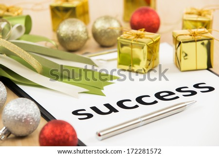 Text success with ribbon and gift close-up #172281572