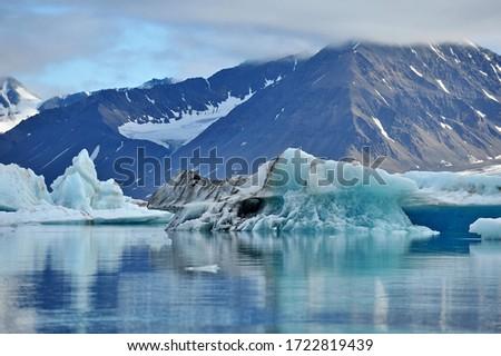 Blue ice drifting iceberg. Landscape of the Svalbard archipelago.